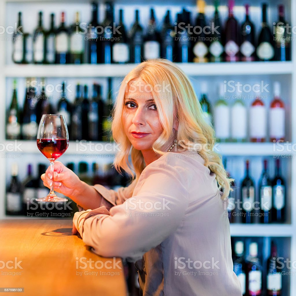 Woman in a wine bar stock photo