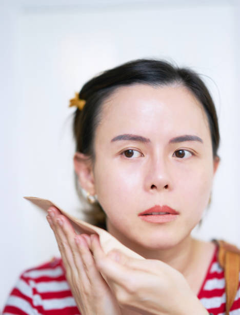 Woman in action of absorb or swept oil with paper on isolated white background Woman in action of absorb or swept oil with paper on isolated white background blotting paper stock pictures, royalty-free photos & images