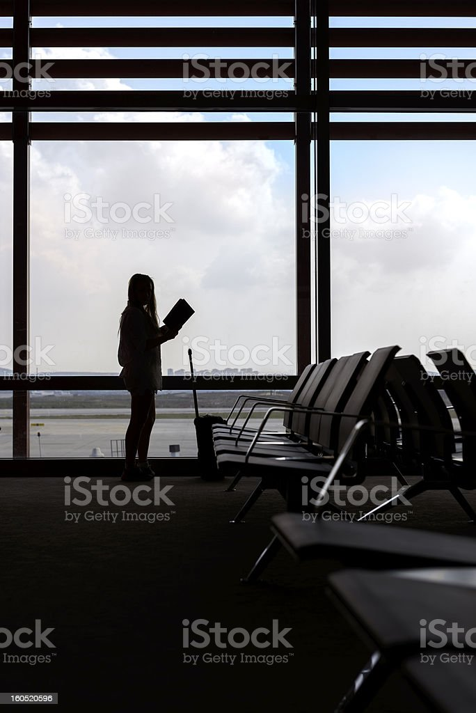 woman in airport royalty-free stock photo