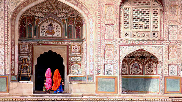 Woman in Amber fort Two women walking in the Amber Fort, Jaipur agra stock pictures, royalty-free photos & images