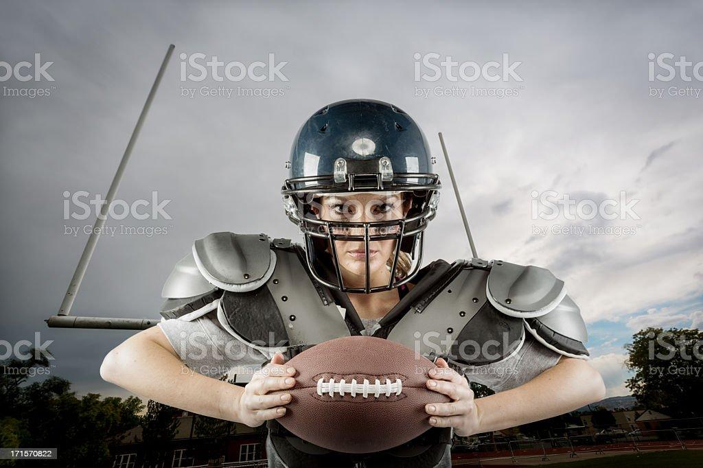 Woman in American Football Gear stock photo