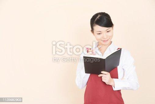 istock Woman in an apron 1125682903