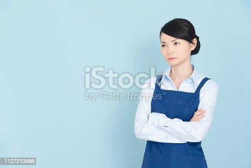 istock Woman in an apron 1127213485