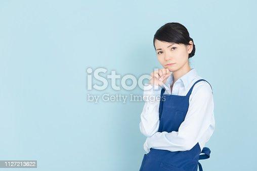 istock Woman in an apron 1127213622