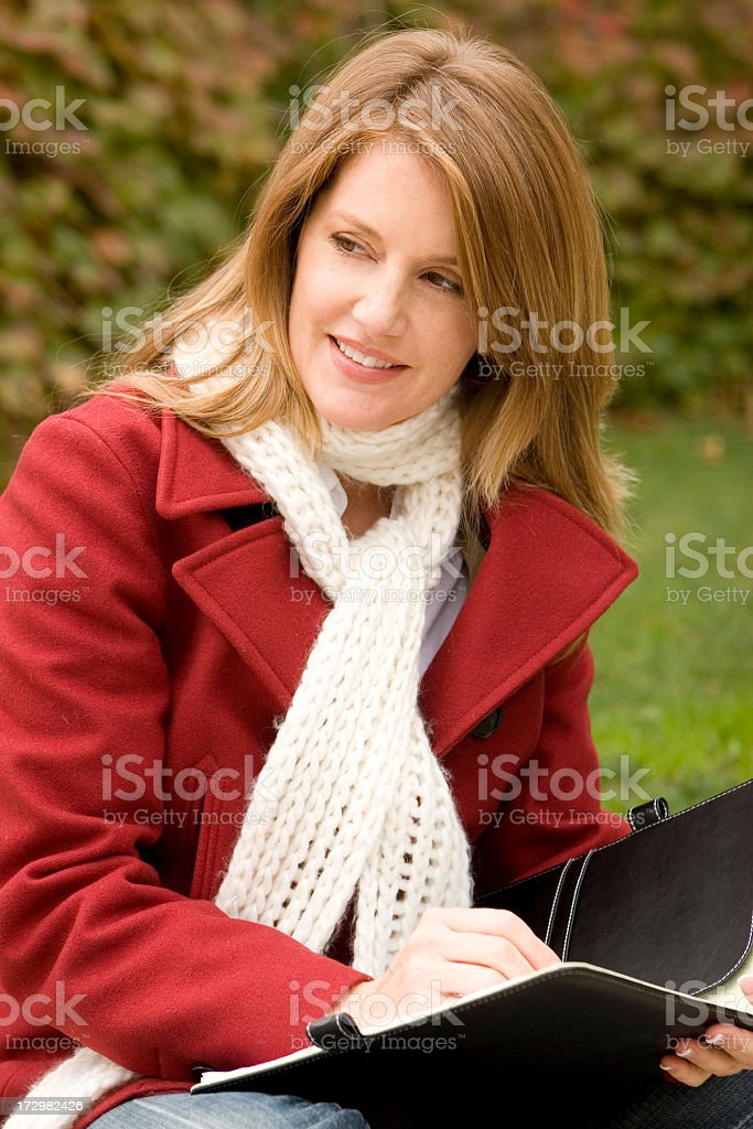 Woman in an autumn setting royalty-free stock photo