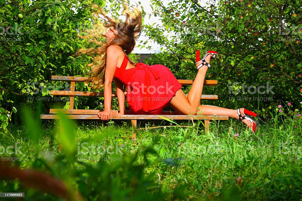 Woman in apple's garden royalty-free stock photo