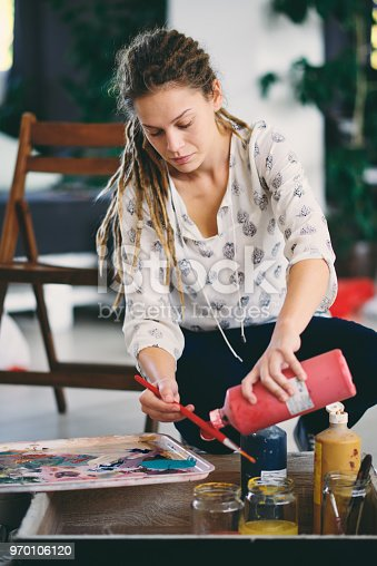937313030 istock photo Woman in atelier. 970106120