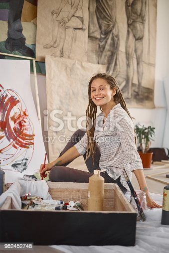 937313030 istock photo Woman in atelier. 982452748