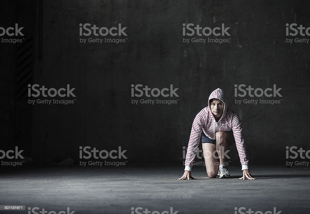 Woman in athletic start position stock photo