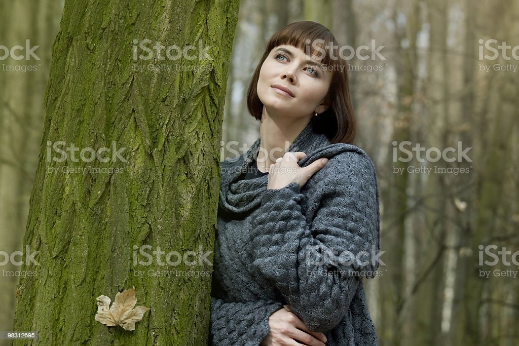 Woman in autumn forest dreaming about something royalty-free stock photo
