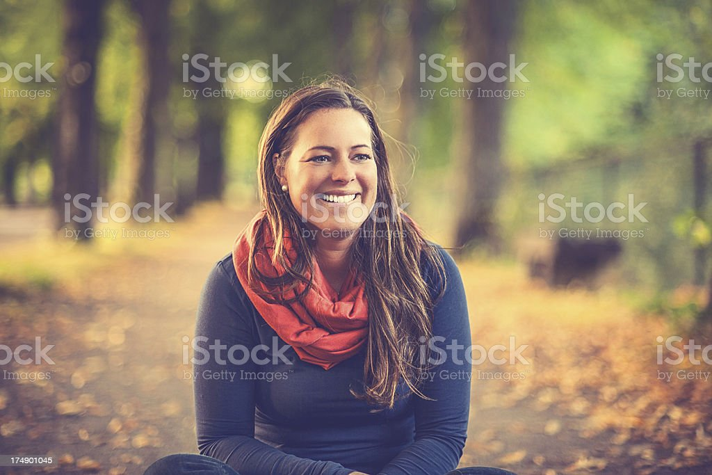 Woman in autumn parkway stock photo