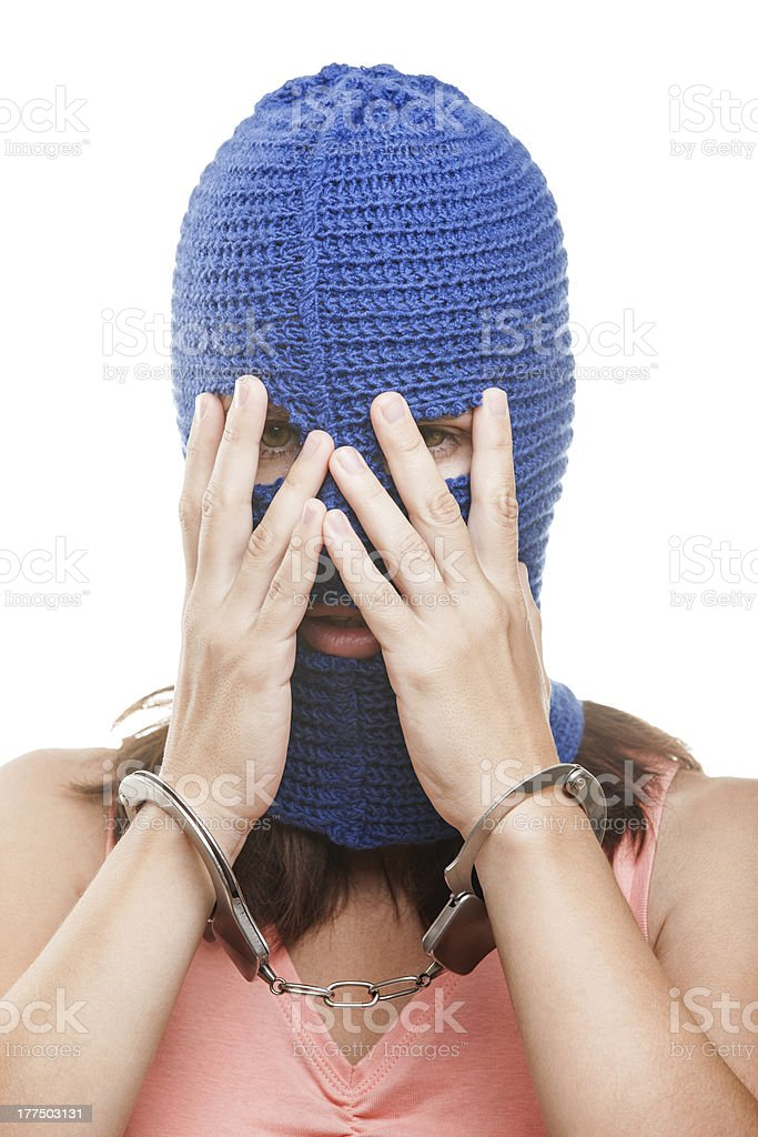 Woman in balaclava hiding face royalty-free stock photo