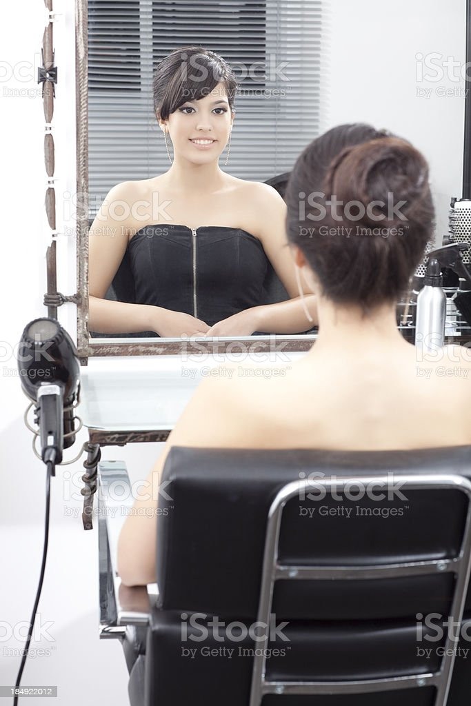Woman in barber shop, back view. royalty-free stock photo