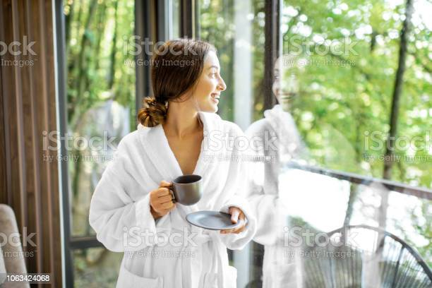 Woman in bathrobe near the window picture id1063424068?b=1&k=6&m=1063424068&s=612x612&h=phpbsdnrpmbrgymqy rslnc8fzbmvm7u6vjkbiof3p8=