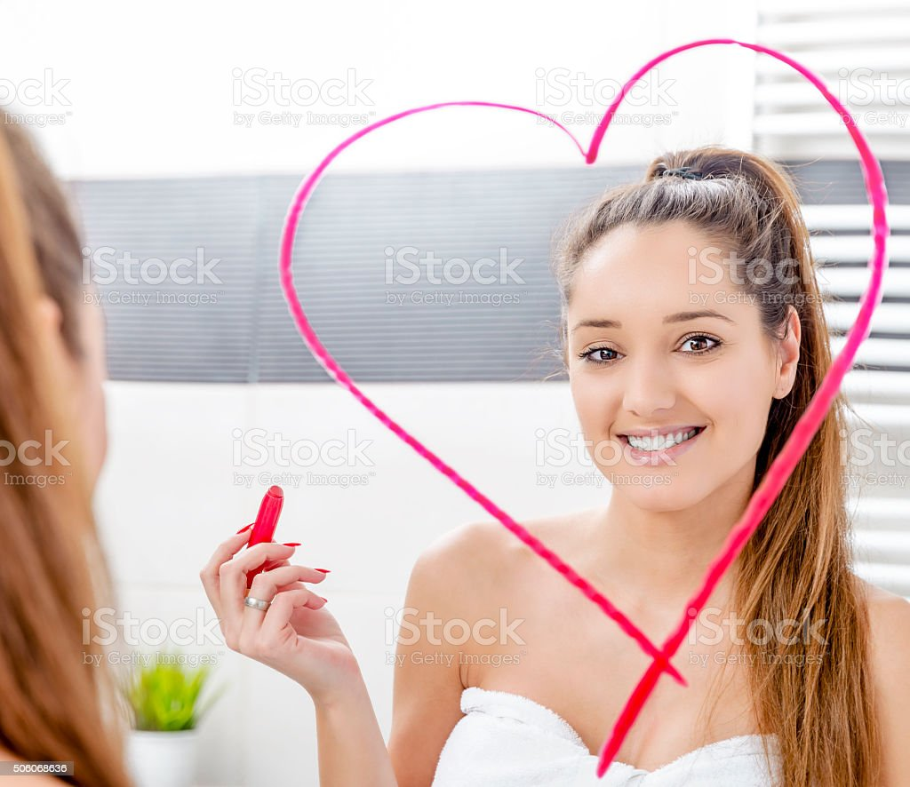 Woman in bathroom. stock photo