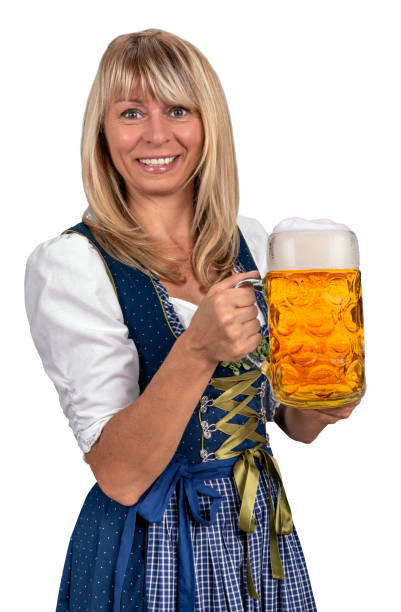 frau in bayrischer tracht dirndl hält eine maß bier auf dem oktoberfest in münchen - bier kostüm stock-fotos und bilder