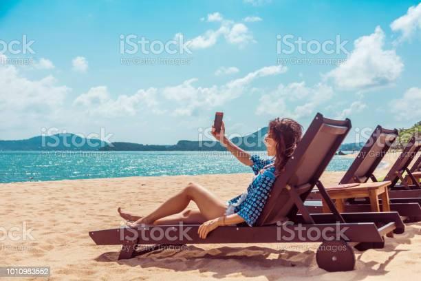 Woman in beach chair picture id1010983552?b=1&k=6&m=1010983552&s=612x612&h=pz6yxnvnye s osyhdmp43aps8prh3ttds9w7be urm=