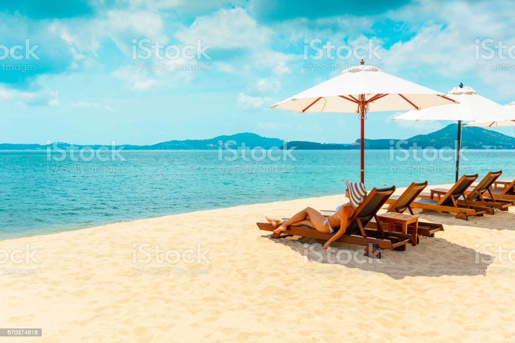 Woman in beach chair stock photo