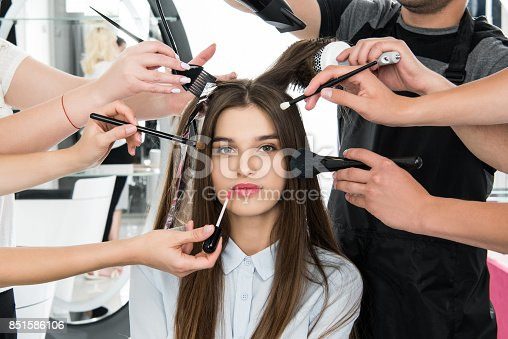 attractive young woman in beauty salon getting styling