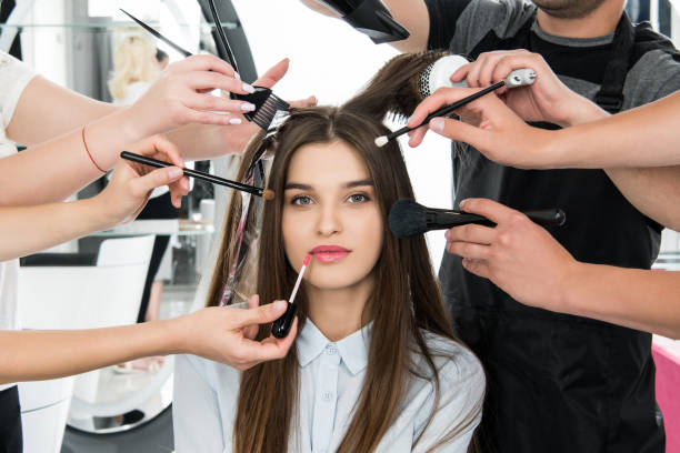 woman in beauty salon getting styling - beauty salon stock photos and pictures