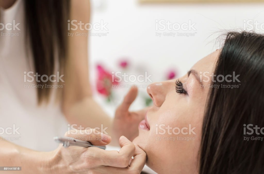 Woman in beauty salon on face treatment stock photo