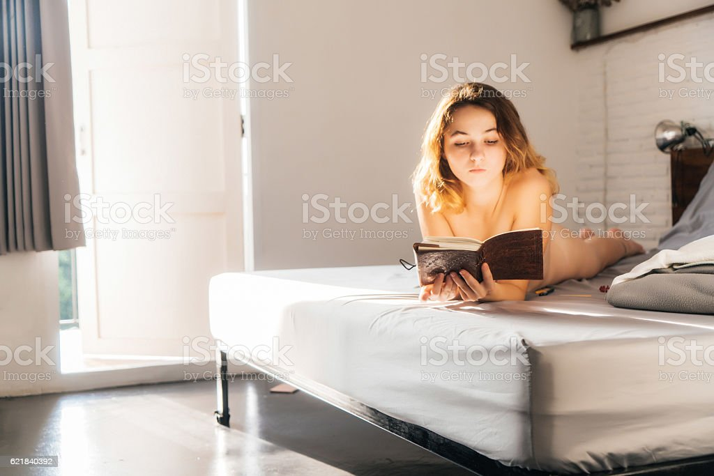 Woman in bed after shower stock photo
