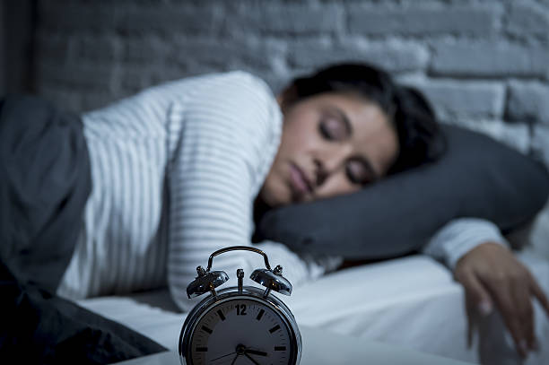 woman in bed late night trying to sleep suffering insomnia – Foto