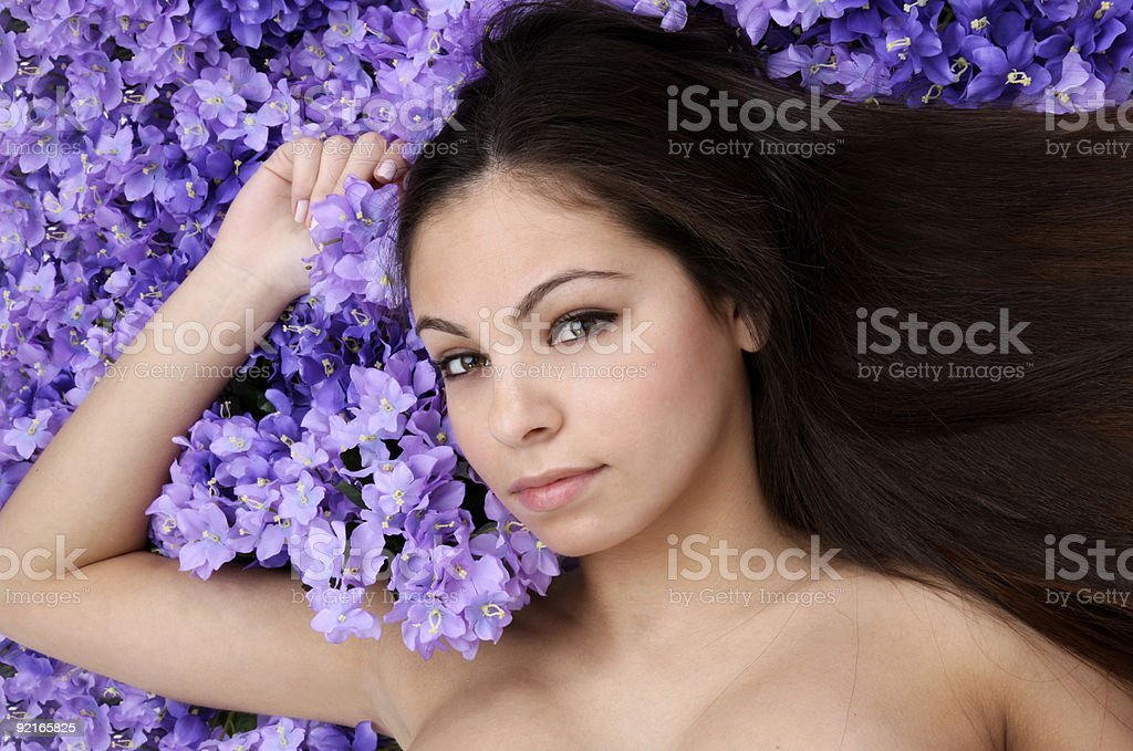 Woman in bed of flowers royalty-free stock photo