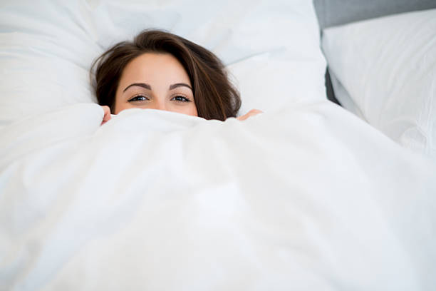 Woman in bed stock photo