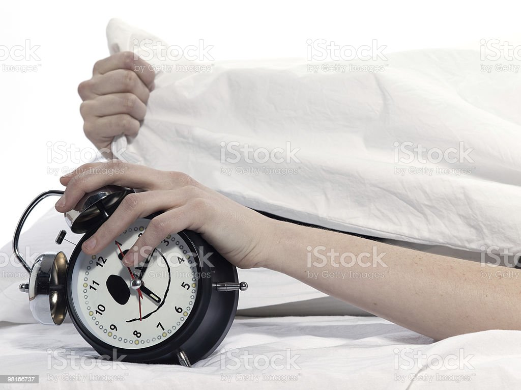 woman in bed rude awakening alarm clock royalty-free stock photo
