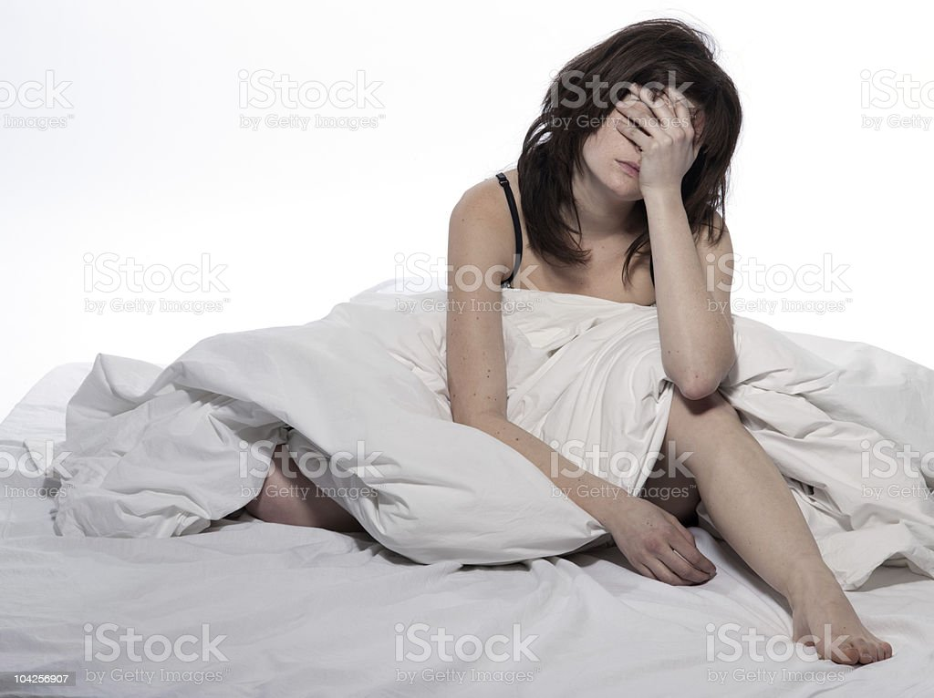 woman in bed rude awakening tired exhausted stock photo