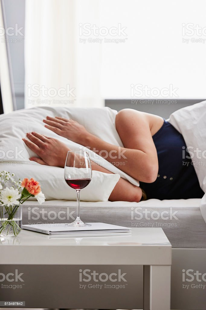 Woman in bed with hangover stock photo