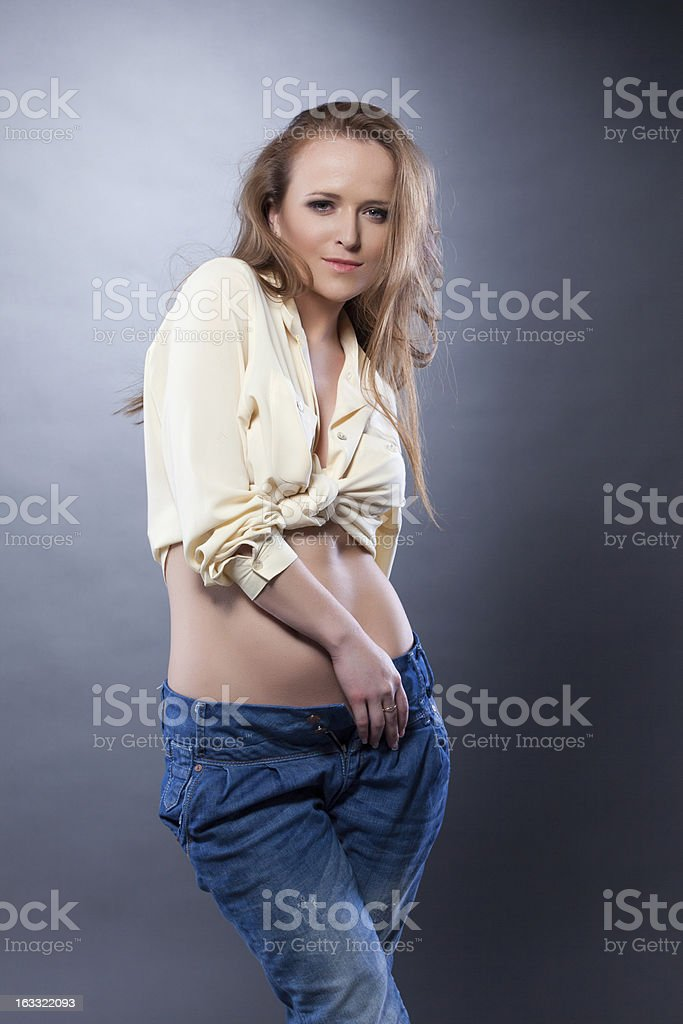 Woman in beige blouse and jeans royalty-free stock photo