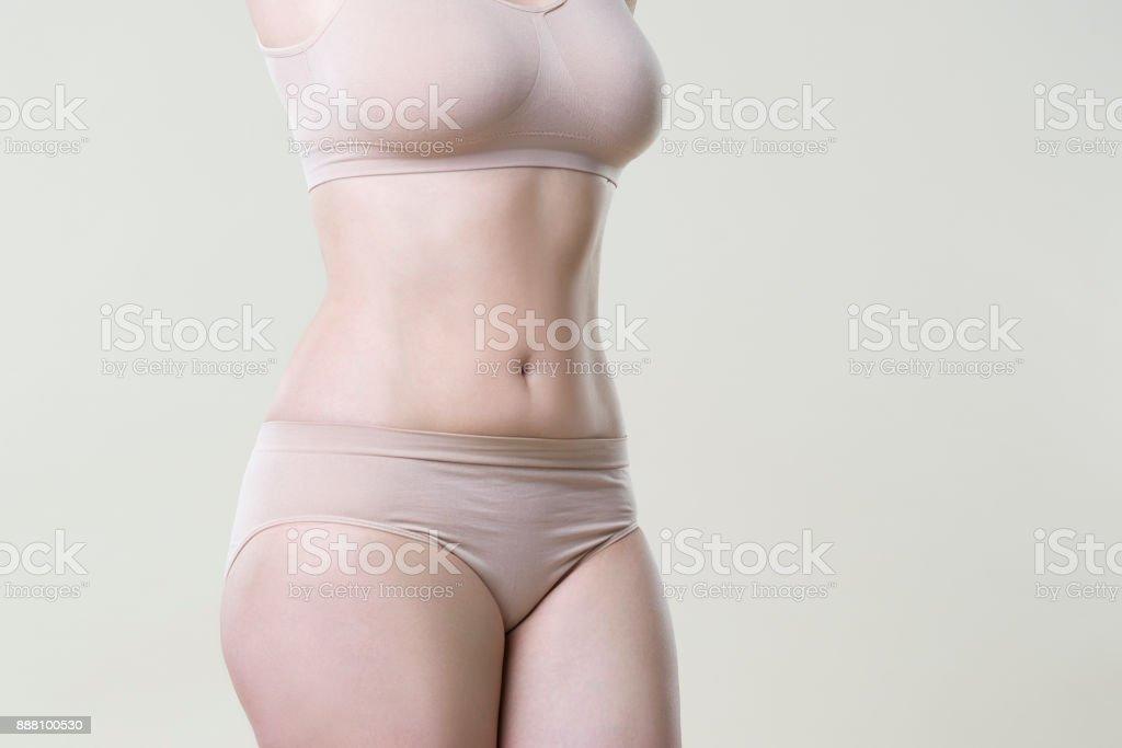 Woman in beige underwear on studio background, perfect female body royalty-free stock photo