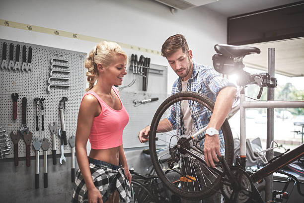 Woman in bicycle store stock photo