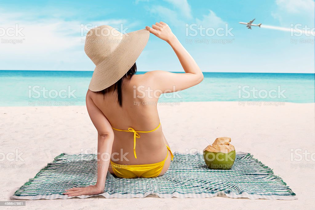Woman in bikini enjoying summertime stock photo