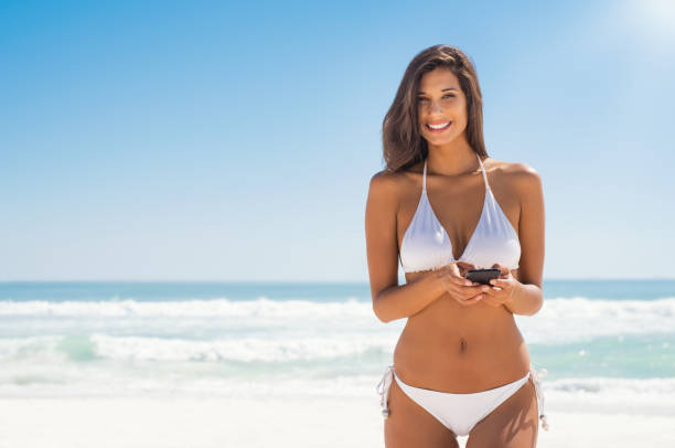 Woman in bikini using phone picture id928866786?b=1&k=6&m=928866786&s=612x612&w=0&h=4jybhb0lwmfb4rffz9gjlxsu4jdoijwjm2l ndbtuls=