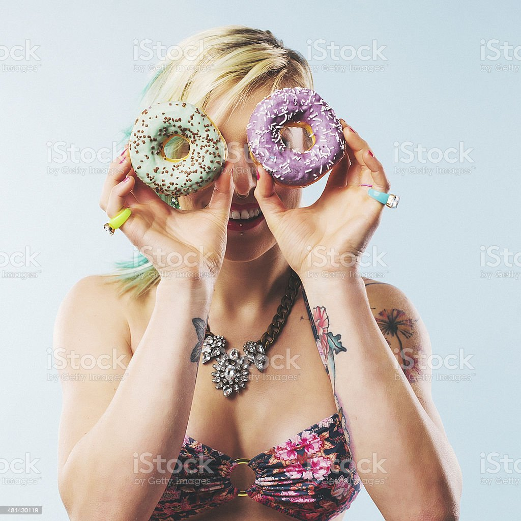 Woman in bikini with donuts stock photo