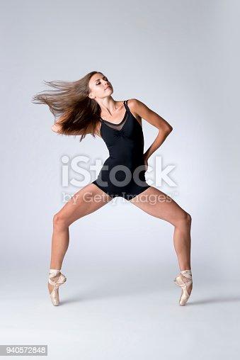 Woman in black biketard dancing en pointe