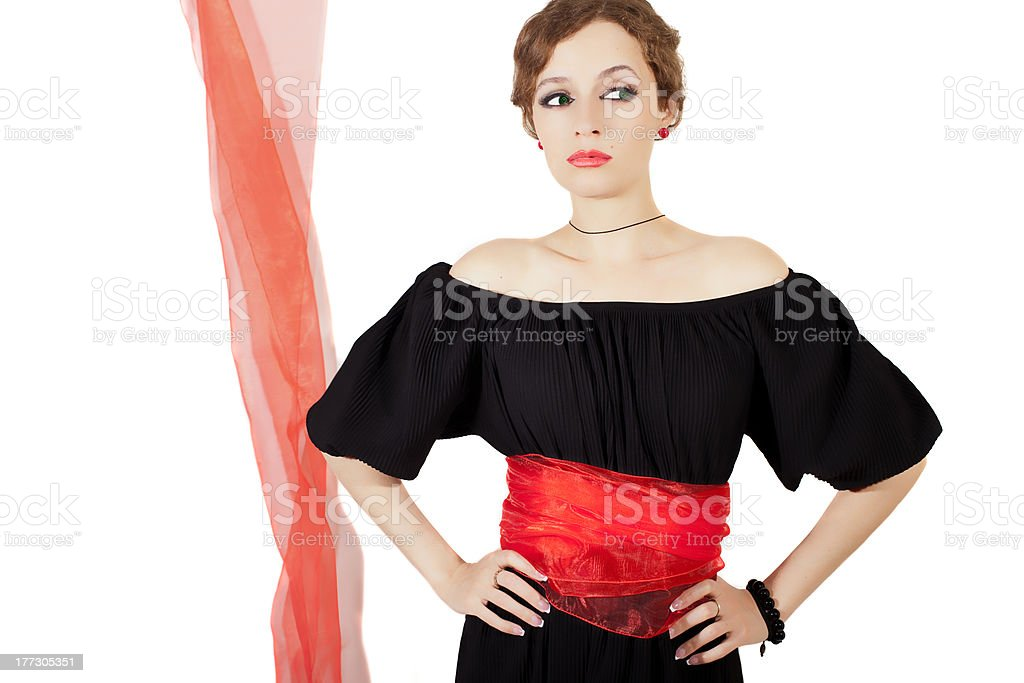 woman in black dress with red sash royalty-free stock photo
