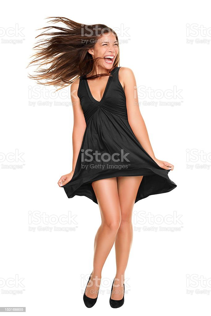 woman in black dress with windy hair stock photo
