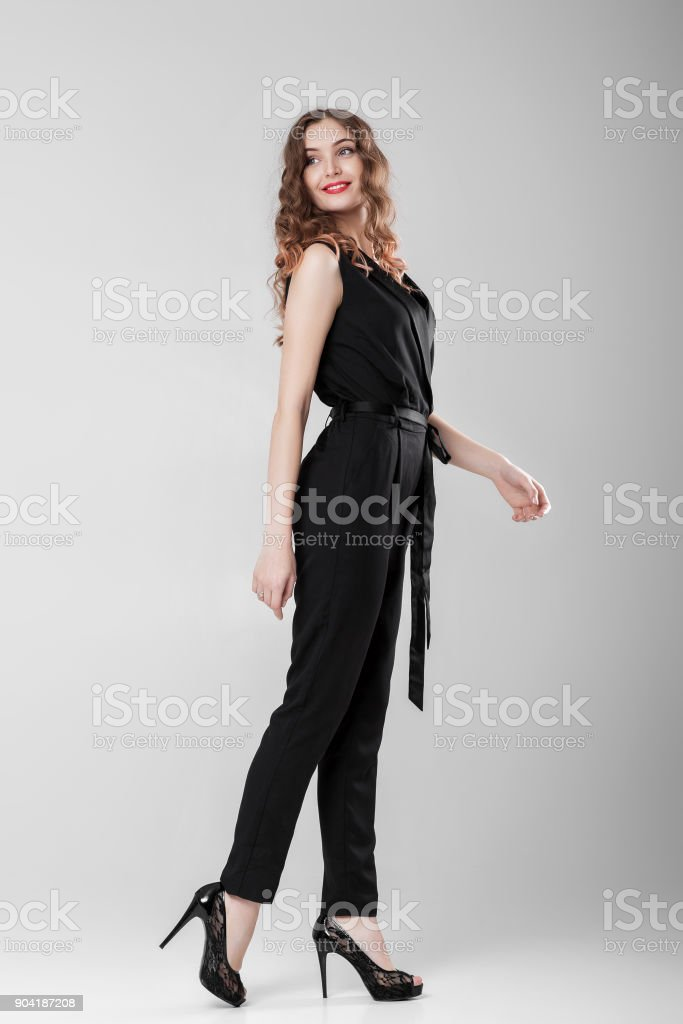 woman in black elegant overall stock photo