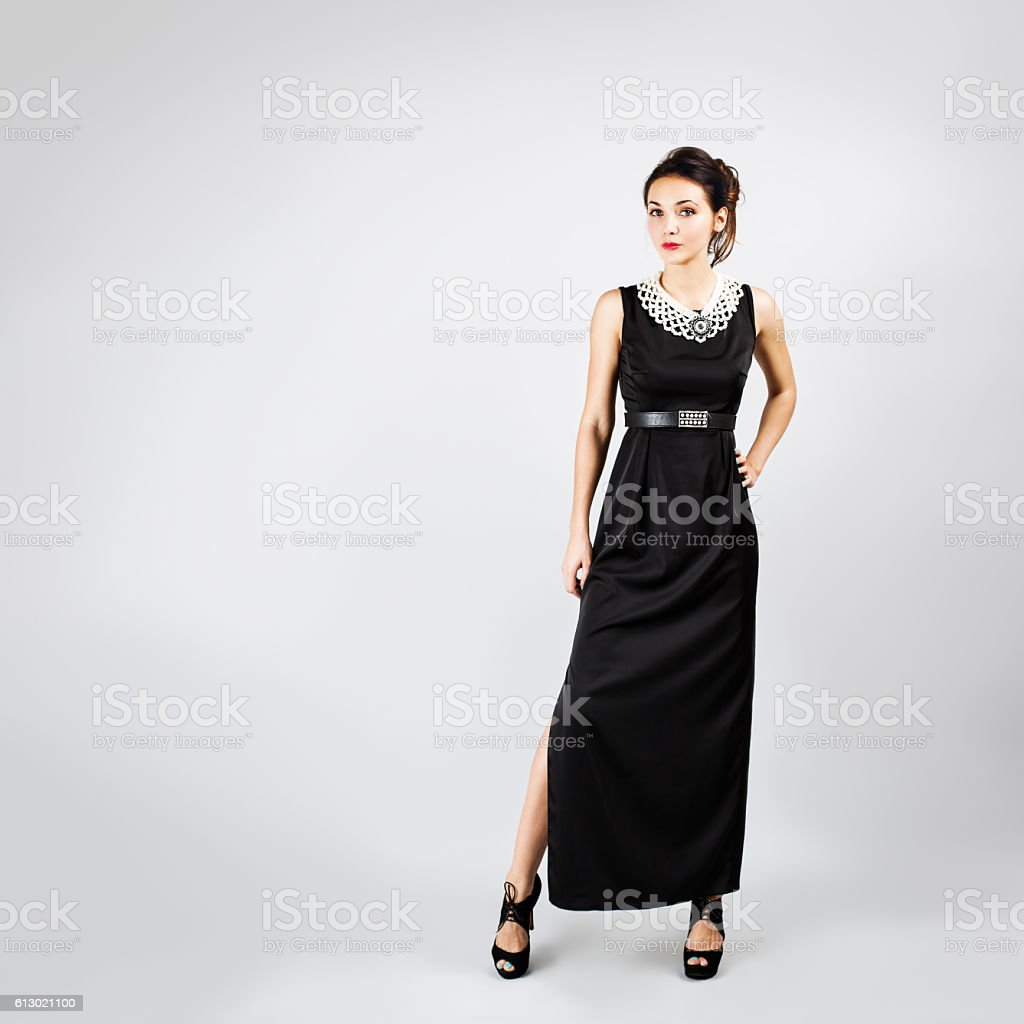 Woman in Black Evening Long Dress on Gray stock photo