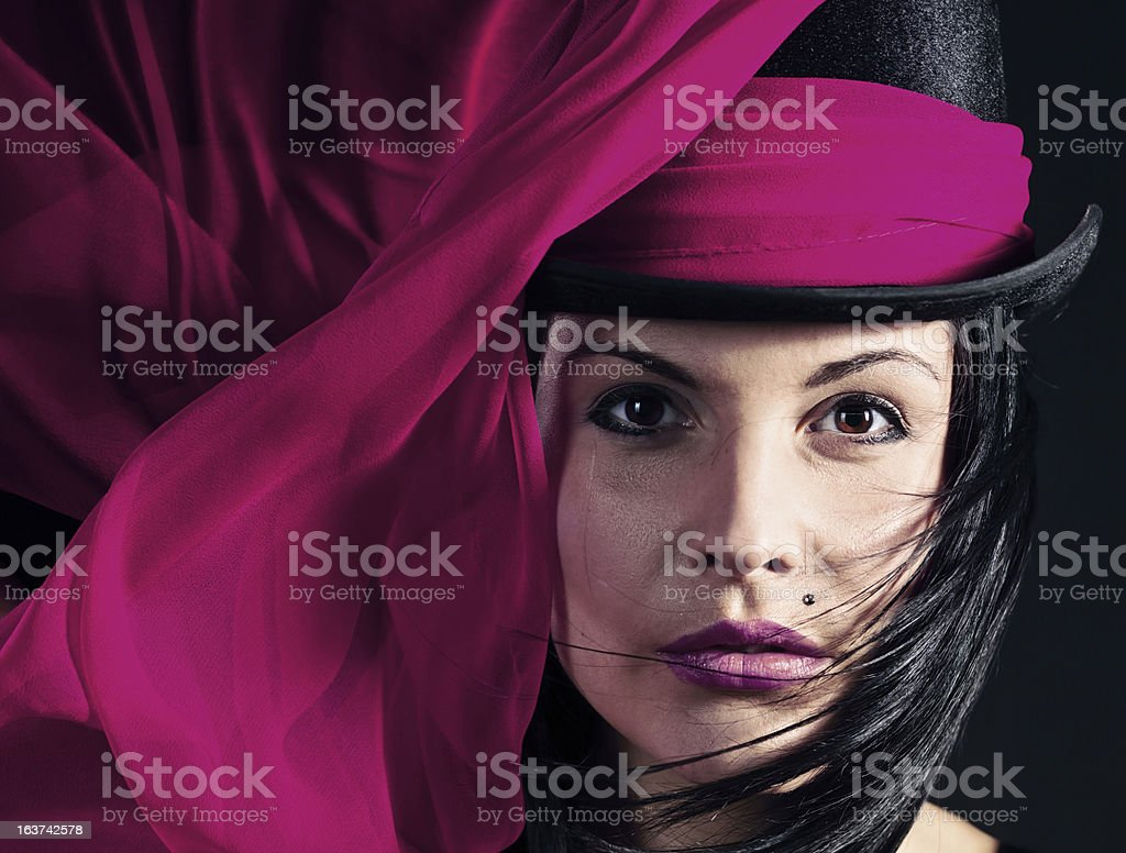 woman in black hat with purple scarf royalty-free stock photo