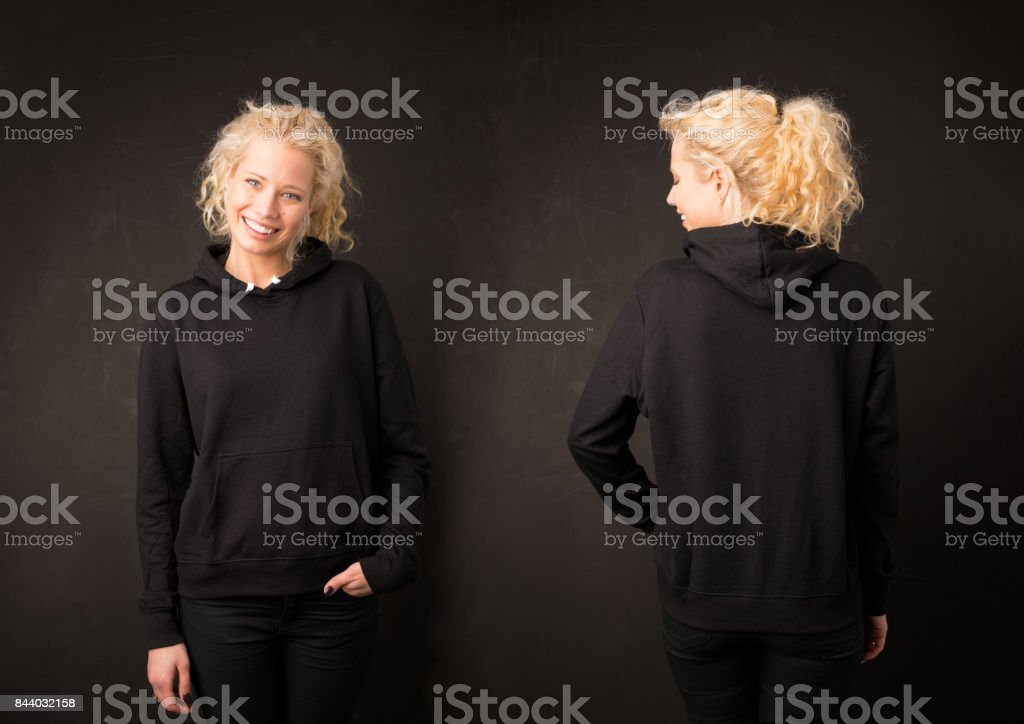 Woman in black hoodie from front and back stock photo