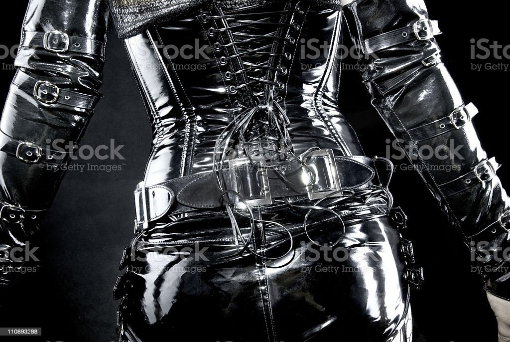 woman in black latex uniform stock photo