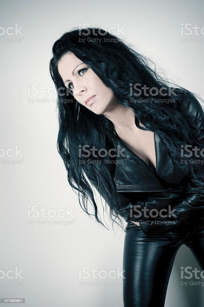 Woman in Black Leather royalty-free stock photo