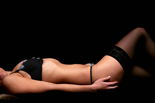 Woman in black lingerie stock photo