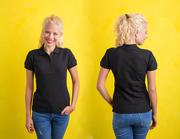 Woman in black polo T-shirt on yellow background stock photo