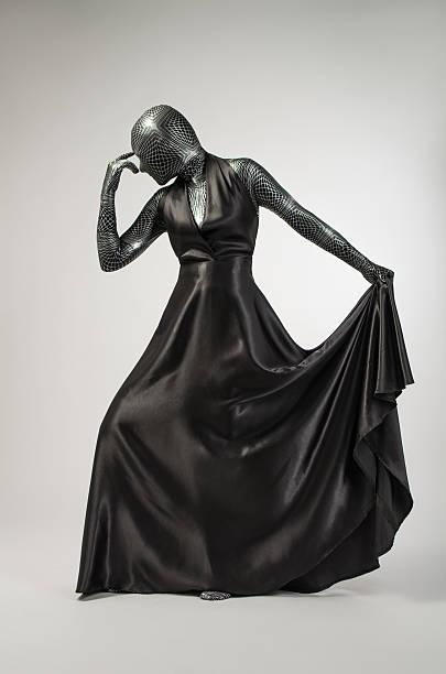 frau in schwarz bademäntel - morphsuit stock-fotos und bilder